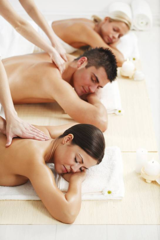 Young people are having a back massage at the spa centre. They are lying.   [url=http://www.istockphoto.com/search/lightbox/9786786][img]http://dl.dropbox.com/u/40117171/couples.jpg[/img][/url]